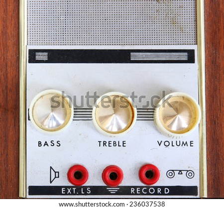 closeup image of grungy vintage record player amplifier dials. selective Focus - stock photo