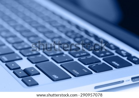 closeup image of laptop keyboard on the table
