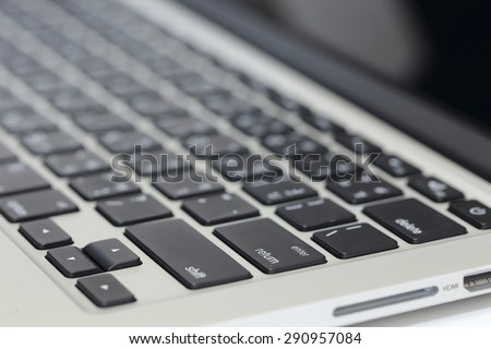 closeup image of laptop keyboard on the table - stock photo