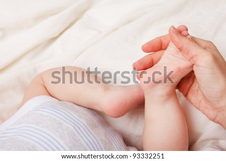 Closeup image of little baby`s footstep
