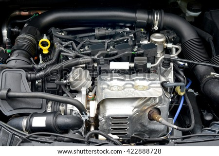 Closeup image of new 3 cylinder turbo powered gasoline engine