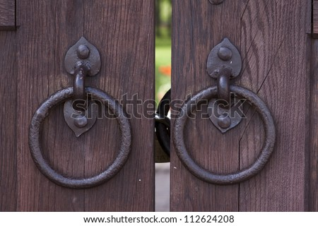 Closeup image of old door with circle iron door-handle - stock photo