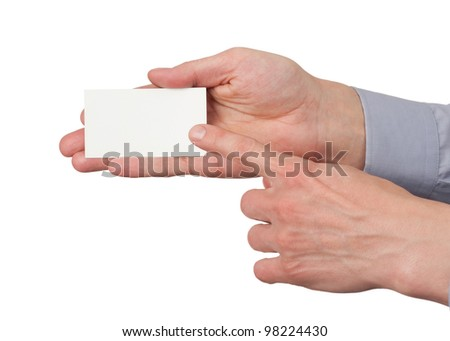 Closeup image of paper business card in male hand, isolated on white background - stock photo