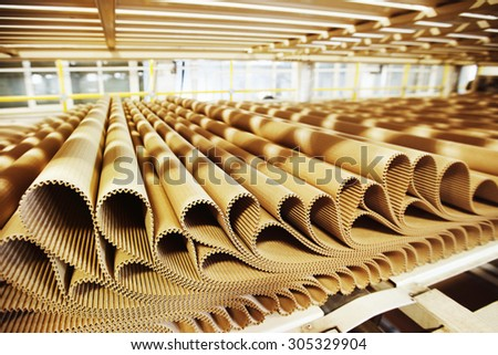 Closeup image of pleat cardboard row at factory background. - stock photo