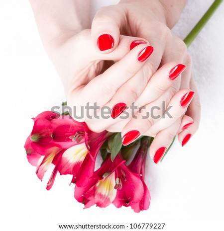 Closeup image of red manicure with flowers