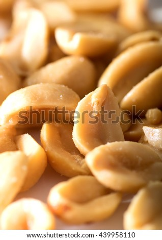 Closeup image of salted nuts on a table