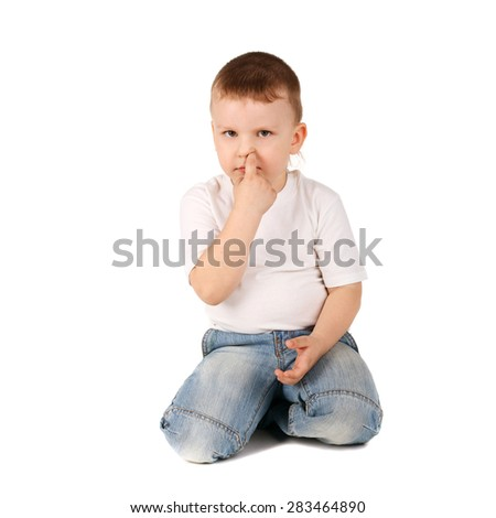 closeup image of the cute little boy picking his nose - stock photo
