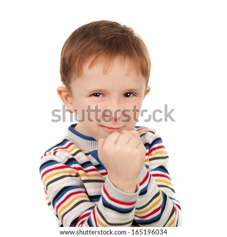 closeup image of the cute little boy ready to fight - stock photo
