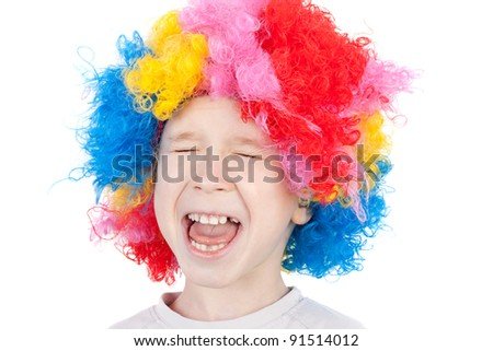 closeup image of the cute little crying clown boy - stock photo