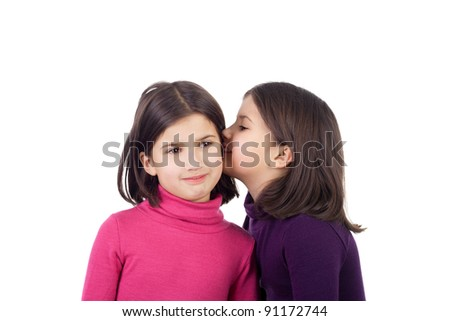closeup image of the cute little twin sisters whispering