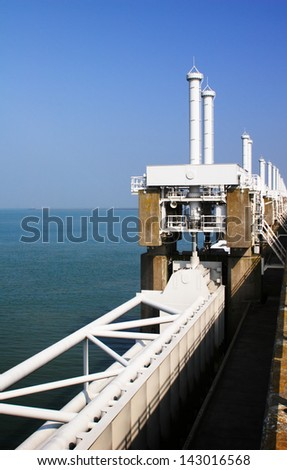 Closeup image of the Dutch Delta Works high water protection barrier at Oosterschelde, Netherlands. - stock photo