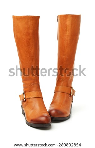 closeup image of the ginger red boots  - stock photo