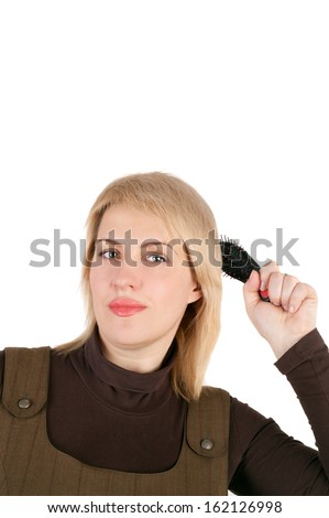 closeup image of the pretty blond woman combing - stock photo