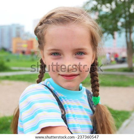 closeup image of the pretty little girl outdoors