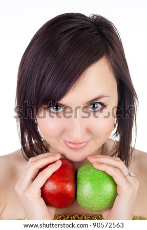 closeup image of the pretty young girl with the red and green apples