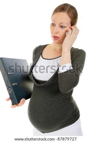 closeup image of the pretty young pregnant business woman speaking a mobile phone