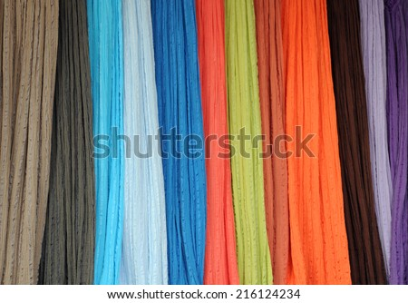 Closeup image of thin bright fabrics at the shop - stock photo