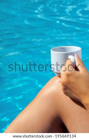 Closeup image of woman legs behind swimming pool, vacation concept - stock photo