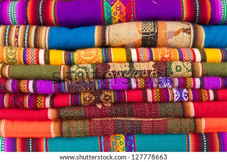closeup image on classic colorful peruvian fabric background