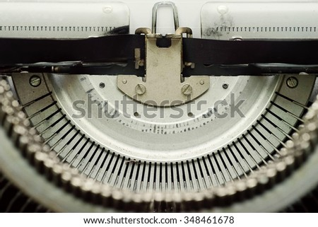 Closeup images of old typewriter letters. Toned and Blurred Background - stock photo