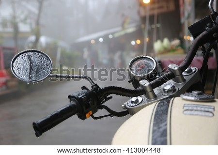 Closeup in some part of vintage motorcycle riding in the rain - stock photo