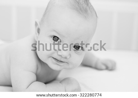 Closeup indoor portrait of a cute little baby boy - stock photo