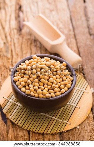 closeup is some soybeans in ceramic bowl .