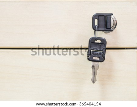 Closeup keys at the wooden drawer texture background  - stock photo