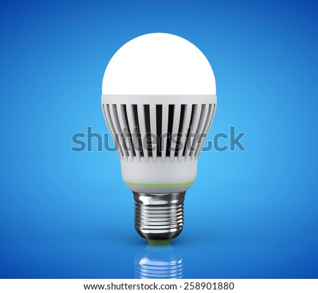 Closeup LED bulb on a blue background - stock photo
