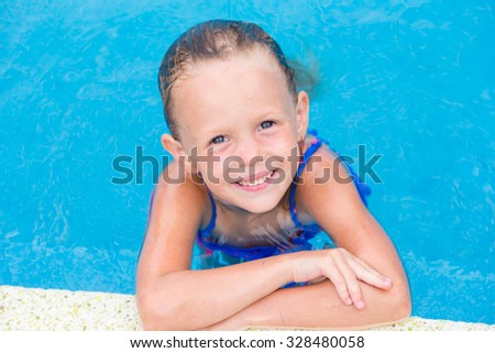 Closeup little beautiful girl in outdoor swimming pool - stock photo