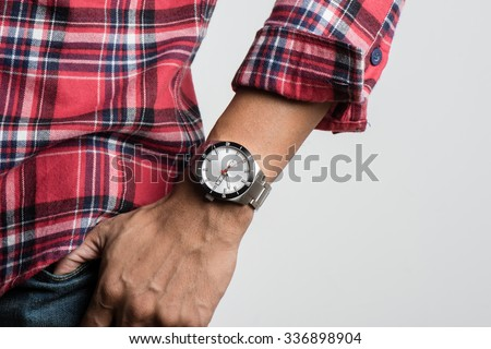 closeup luxury watch on man's wrist