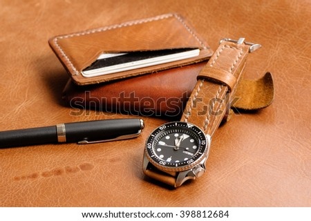 closeup luxury watch with handmade brown leather watch strap