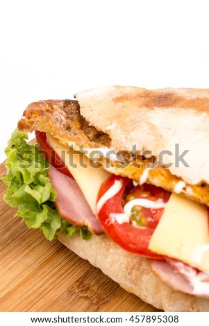 Closeup macro bread sandwich meat tomato cheese