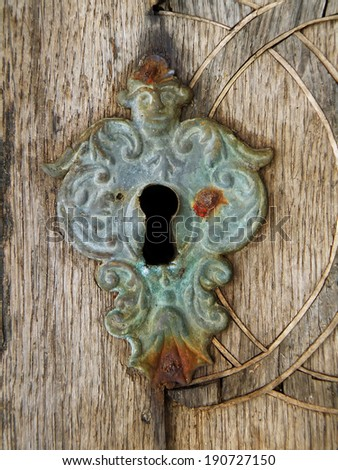 Closeup macro detail of old keyhole. Medieval lock. - stock photo