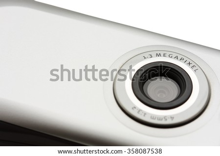Closeup macro of camera on mobile phone isolated on white background.