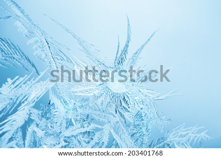 closeup macro of ice crystals on glass for background or texture, blue tone - stock photo