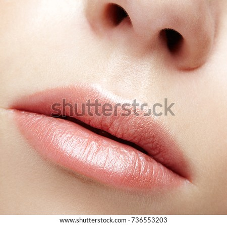 Closeup macro portrait of female part of face. Human woman lips with day beauty makeup. Girl with perfect lips shape.