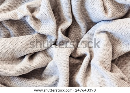 Closeup macro texture of knitted cotton waffle fabric, clothing background with wrinkles and folds - stock photo