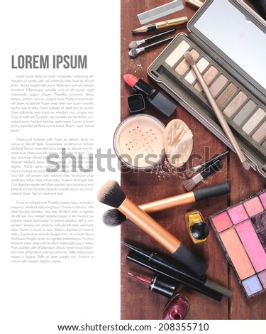 closeup makeup brush cosmetics on wooden plank background - stock photo