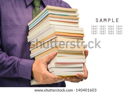 Closeup man holding a pile of used books isolated on white background