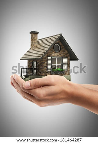 Closeup. Man's hand holding house High resolution