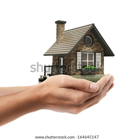 Closeup. Man's hand holding house  isolated on white background. High resolution
