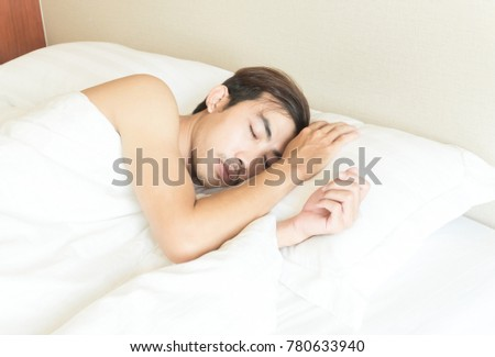 Closeup man sleeping on bed, health care and medical concept, selective focus