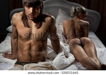Closeup man with woman while lying in bed at home - stock photo