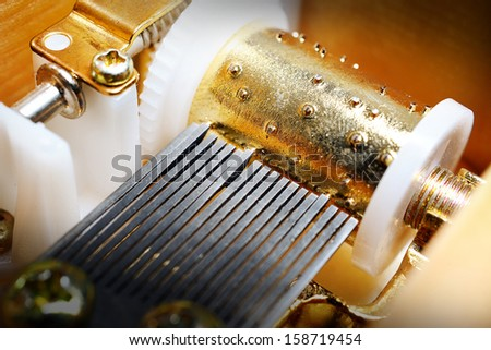 closeup mechanism of classic music box - stock photo