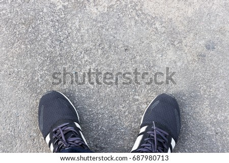 Closeup Men Shoes On Cement Floor Top View And Over Light