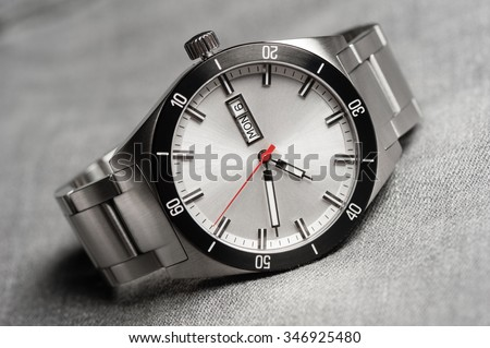 closeup men watch with stainless steel bracelet