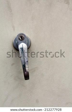 Closeup metal door with lock in grungy door - stock photo