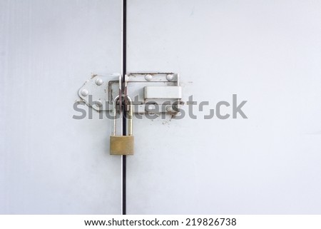 Closeup metal door with lock with copyspace on the right - stock photo