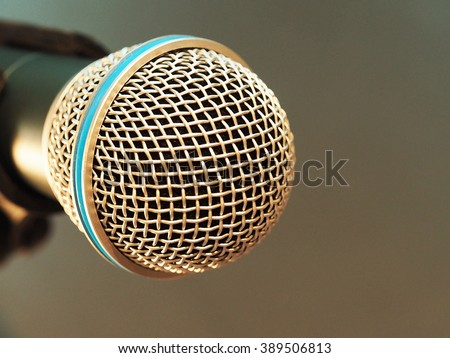 closeup microphone in meeting room with blurred background and ink brush effect filter